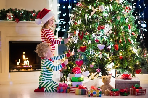 Little Boy & Girl Decorating a Christmas Tree in House - Oregon Pine Trees Blogs
